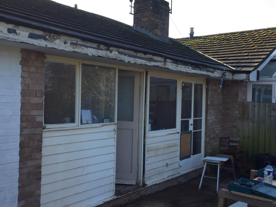 Before shot of cladding installation on side of house