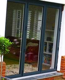 Black french sliding doors on modern white property