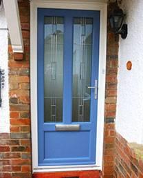 Blue front door with long window details