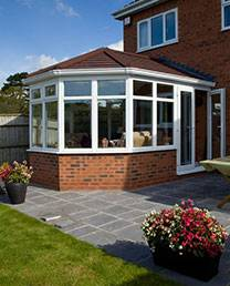 New conservatory installation on side of brick house