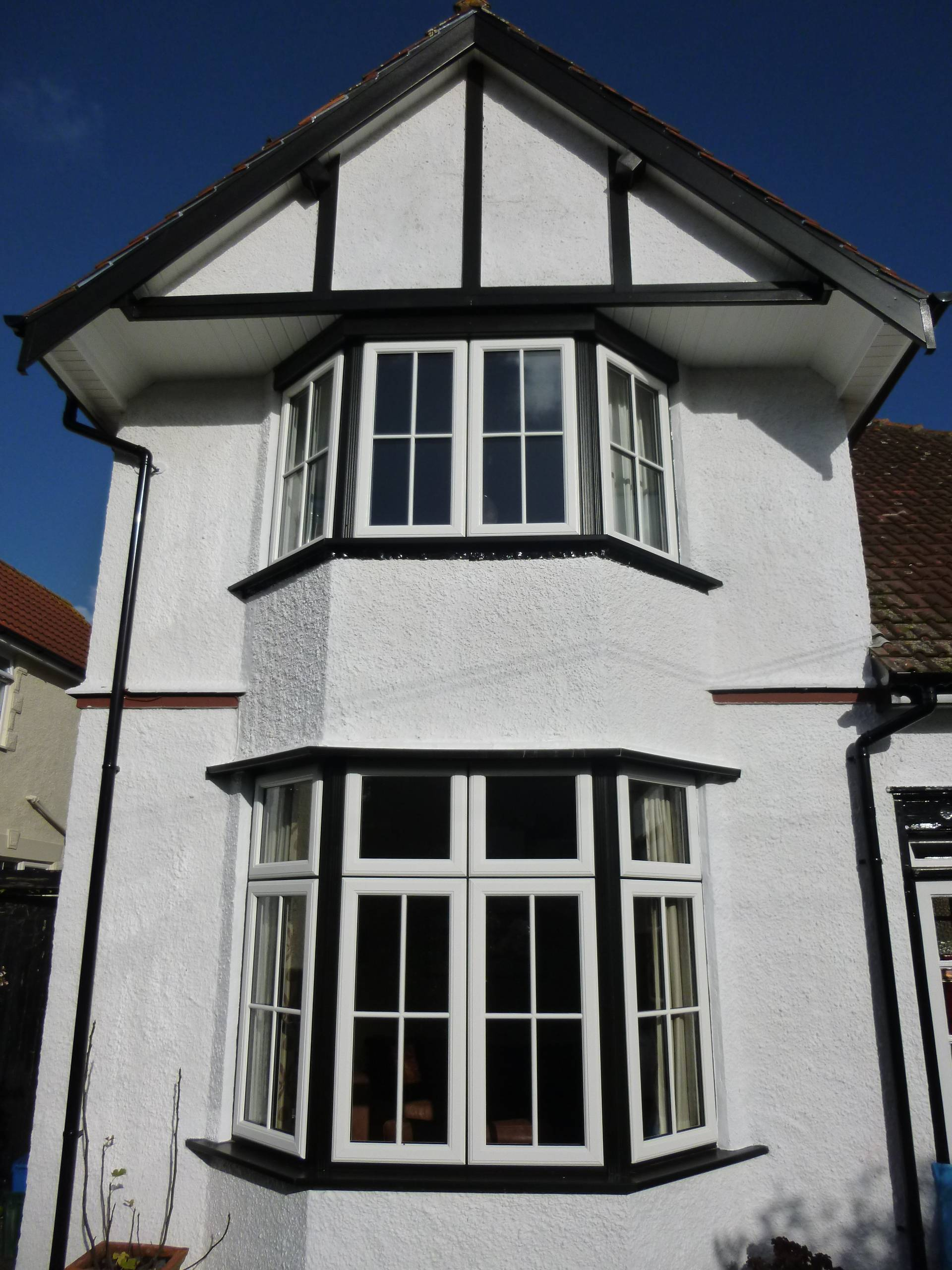 white and black traditional property with new bay window installations